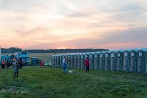 Outhouses porta potties dusk stonehenge summer solstice  england allan