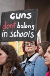 Red haired woman with guns don't belong in schools sign March for Our Lives rally protest guns sacramento california 3242018 DSC 9027