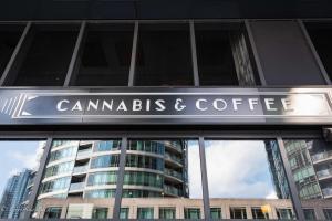 Sign cannabis & coffee shop store toronto ontario reflections buildings allan DSC 1660