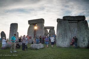 Sunburst through stones stonehenge summer solstice  england allan