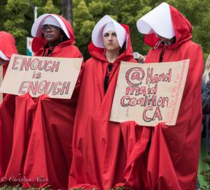 Three red robed people handmaid coalition signs enough is enough March for Our Lives rally protest guns sacramento california 3242018 DSC 9064